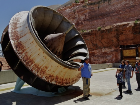 This is Curtis, our awesome tour guide at Glen Canyon Dam. He's standing in front of a turbine from one of the generators.