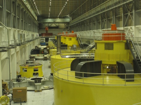 Generators inside Glen Canyon Dam. You can see one that is disassembled for maintenance work.